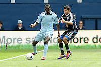 Kansas City forward C. J Sapong (17) holds off  Steven Beltashour San Jose defender... Sporting Kansas City defetaed San Jose Earthquakes 2-1 at LIVESTRONG Sporting Park, Kansas City, Kansas.