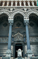Basilica Notre-Dame de Fourviere, entry detail with elaborate carved stone and statues, Lyon, France