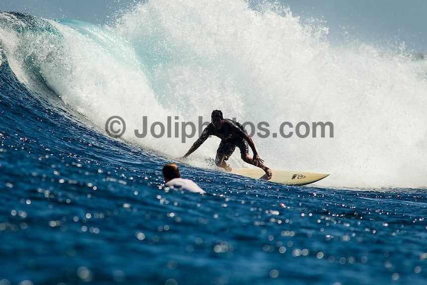Namotu Island Resort, Fiji. (Saturday, September 8, 2012) -  Yesterday's trong winds  had backed off thsi morning with Cloudbreak, Namotu lefts and Wilkes provided waves in the 4'-6' range. The swell slowly dropped through the day and so did the wind.  Photo: joliphotos.com