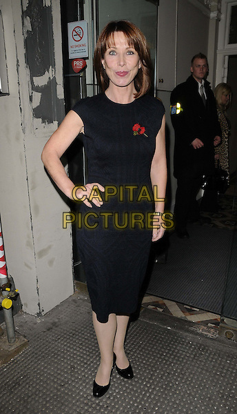Kay Burley  .'Dangerous Women: The Guide To Modern Life' book launch party, Twentieth Century Theatre, Westbourne Grove, London, England..1st November 2011 .full length black dress poppy hand on hip.CAP/CAN.©Can Nguyen/Capital Pictures.
