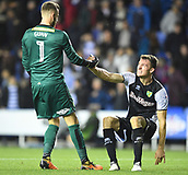 30th September 2017, Madejski Stadium, Reading, England; EFL Championship football, Reading versus Norwich City; Angus Gunn of Norwich City helps Christoph Zimmermann of Norwich City to his feet on the final whistle