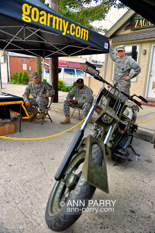 Sept. 22, 2012 - Bellmore, New York U.S. - At the Military Expo section of the 26th Annual Bellmore Family Street Festival, are U.S. Army choppers (motocycles) and soldiers that are army recruiters. More people than the well over 120,000 who attended last year were expected, according to the Festival Coordinator.