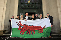 Lord Mayor for Swansea David Hopkins with his wife and Lady Mayoress elect Beverley (C) joined by Paul Smith of Swansea Council (L). Deb Vine (2nd L), Julie Peconi (3rd L) holding a Wales flag in the shape of a red lobster instead of a red dragon outside the Guildhall, to raise awareness for Skin Care Cymru, in Swansea, Wales, UK. Tuesday 28 February 2017