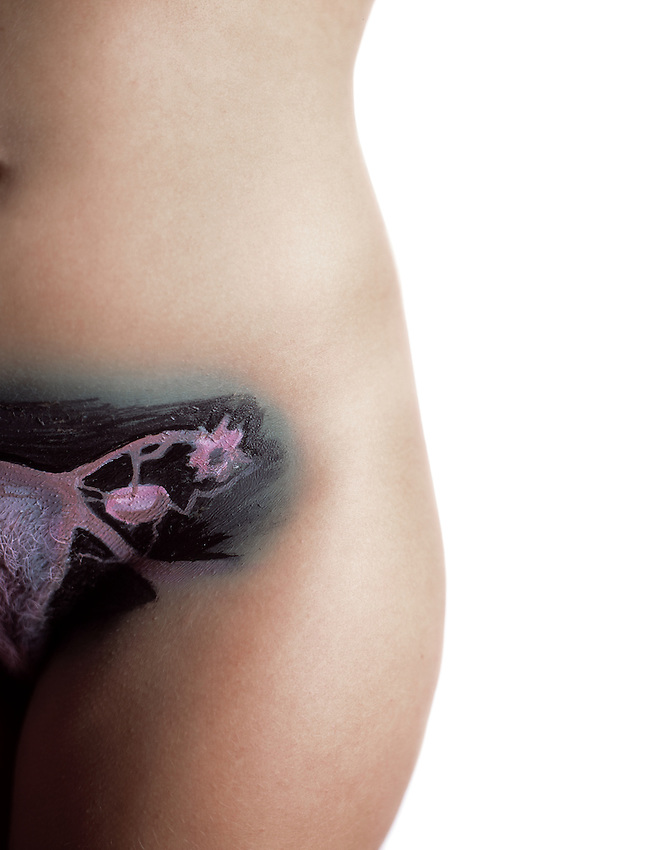 Nude bodies painted to &quot;reveal&quot; underlying body parts.<br /> <br /> Body painting by Larry Ware.