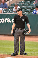 Home plate umpire Ryan Powers during the game against the Orem Owlz and Ogden Raptors n Pioneer League action at Lindquist Field on August 20, 2014 in Ogden, Utah.  (Stephen Smith/Four Seam Images)