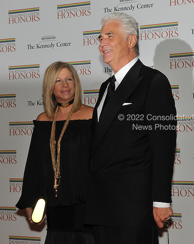 Barbra Streisand, who is one of the 2008 Kennedy Center honorees, and her husband, James Brolin, arrive for the formal Artist's Dinner at the United States Department of State in Washington, D.C. on Saturday, December 6, 2008 to honor 2008 recipients of the Kennedy Center Honors..Credit: Ron Sachs / CNP