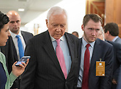 United States Senator Orrin Hatch (Republican of Utah) responds to a reporter's question in the hallway during a break in the testimony of Dr. Christine Blasey Ford  before the US Senate Committee on the Judiciary on the nomination of Judge Brett Kavanaugh to be Associate Justice of the US Supreme Court to replace the retiring Justice Anthony Kennedy on Capitol Hill in Washington, DC on Thursday, September 27, 2018.   <br /> Credit: Ron Sachs / CNP<br /> (RESTRICTION: NO New York or New Jersey Newspapers or newspapers within a 75 mile radius of New York City)