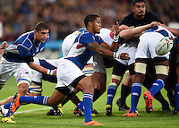 Eugene Jantjies of Namibia passes the ball. Rugby World Cup Pool C match between New Zealand and Namibia on September 24, 2015 at The Stadium, Queen Elizabeth Olympic Park in London, England. Photo by: Patrick Khachfe / Onside Images