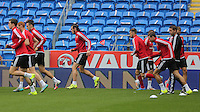 CARDIFF, WALES - SEPTEMBER 05: Gareth Bale (C) warms up with team mates prior to the Wales training session, ahead of the UEFA Euro 2016 qualifier against Israel, at the Cardiff City Stadium on September 5, 2015 in Cardiff, Wales.
