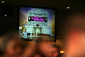 """A projected image is shown on a large screen during United States President Barack Obama's speach at the annual White House Correspondent's Association Gala at the Washington Hilton Hotel, Washington, DC, Saturday, April 30, 2011. The President used the image to show what a """"Trump"""" White House might look like..Credit: Martin Simon / Pool via CNP"""