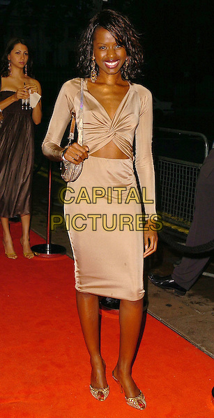 JUNE SARPONG.CRE Race in the Media Awards, .London, June 28th 2005..full length brown bronze dress cut out tummy midriff.Ref: CAN.www.capitalpictures.com.sales@capitalpictures.com.©Can Nguyen/Capital Pictures