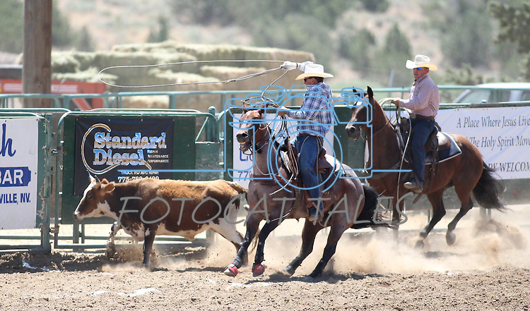 Jeremy Simmonich and Clint Grimes compete in the team roping event at the Minden Ranch Rodeo on Saturday, July 23, 2011, in Gardnerville, Nev..Photo by Cathleen Allison