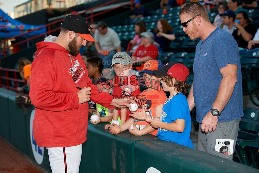 Richmond Flying Squirrels pitcher Dan Slania (45) signs autographs for fans beore a game against the Trenton Thunder on May 11, 2018 at The Diamond in Richmond, Virginia.  Richmond defeated Trenton 6-1.  (Mike Janes/Four Seam Images)