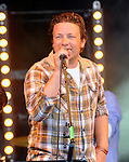 Jamie Oliver and alex james live on stage with the producers at the big feastival/09/2012