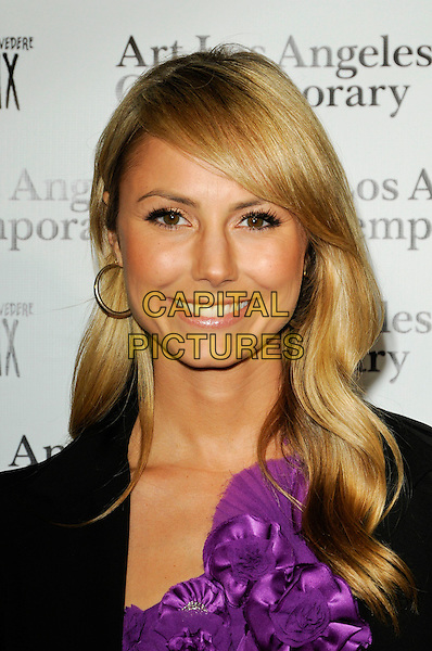 STACY KEIBLER.The Art Los Angeles Contemporary Art Fair at Pacific Design Center on January 28, 2010 in West Hollywood, California, USA..January 28th, 2010.headshot portrait black purple top hoop earrings corsage flower .CAP/ROT.©Lee Roth/Capital Pictures