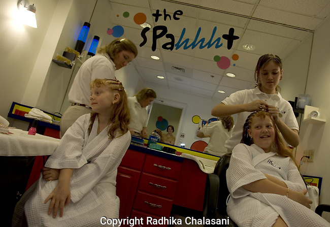SAN ANTONIO, TEXAS-MARCH 25, 2005: Ireland Buckley (7) and her sister,Diandra (10), visit Spaaht, the kids-only spa at the Hyatt Regency Hill Country Resort, to have their hair braided and get their nails painted.    (Photo by Radhika Chalasani)