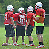 East Islip teammates gather during football practice at the high school on Wednesday, August 19, 2015.