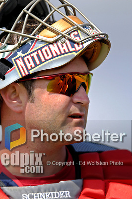 25 February 2007: Washington Nationals catcher Brian Schneider gets ready to take up catching in the batting cage during batting practice at their spring training facility in Viera, Florida.<br /> <br /> Mandatory Photo Credit: Ed Wolfstein Photo