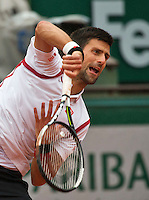 Paris, France, 31 June, 2016, Tennis, Roland Garros, Novak Djokovic (SRB) serves the ball<br /> Photo: Henk Koster/tennisimages.com