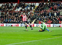 Neal Maupay of Brentford looks for  of Leeds United to spill the ball during the Sky Bet Championship match between Brentford and Leeds United at Griffin Park, London, England on 4 November 2017. Photo by Carlton Myrie.