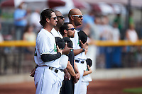 Clinton LumberKings manager Scott Steinmann (22) stands with his coaching staff during the national anthem before a game against the Great Lakes Loons on August 16, 2015 at Ashford University Field in Clinton, Iowa.  Great Lakes defeated Clinton 3-2.  (Mike Janes/Four Seam Images)