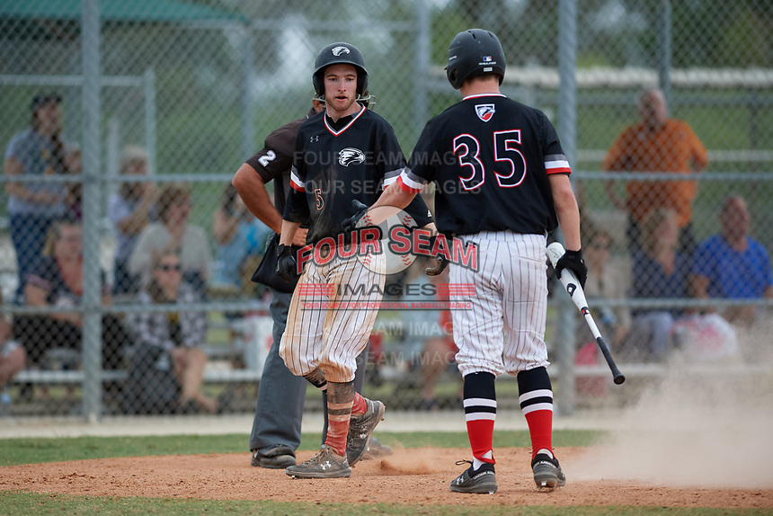 Edgewood Eagles Ryan Cassady (5) is congratulated by Kamdan Bloom (35) after scoring a run during a game against the South Vermont Mountaineers on March 18, 2019 at Lee County Player Development Complex in Fort Myers, Florida.  South Vermont defeated Edgewood 19-6.  (Mike Janes/Four Seam Images)