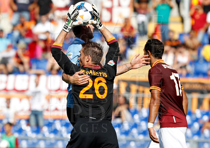 Calcio, Serie A: Roma vs Lazio. Roma, stadio Olimpico, 22 settembre 2013.<br /> AS Roma goalkeeper Morgan De Sanctis, left, grabs the ball past Lazio forward Miroslav Klose, of Germany, partially hidden, and AS Roma defender Mehdi Benatia, of France, right, during the Italian Serie A football match between AS Roma and Lazio, at Rome's Olympic stadium, 22 September 2013.<br /> UPDATE IMAGES PRESS/Isabella Bonotto