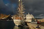 Tall masted ship Christian Radich and German cruise ship Europa, docked in Santa Cruz harbour, Tenerife, Canary Islands.