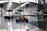 Passengers wait for trains at platforms inside María Zambrano railway station Malaga, Spain