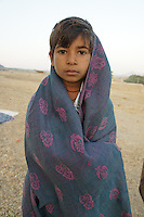 boy in the desert close to   camel fair in holy city Pushkar, Rajastan, India