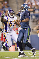 Seattle Seahawks quarterback Tarvaris Jackson (7) is rushed by Minnesota Vikings defensive end Adrian Awasom (67) at CenturyLink Field in Seattle, Washington. The Minnesota Vikings won the game, 20-7.