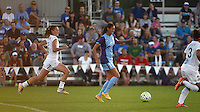 Kansas City, MO - Saturday May 28, 2016: FC Kansas City midfielder Mandy Laddish (7) chases Orlando Pride  forward Christina Burkenroad(11). FC Kansas City defeated Orlando Pride 2-0 during a regular season National Women's Soccer League (NWSL) match at Swope Soccer Village.