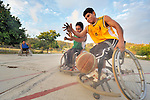 Alejandro Jarquin and Roel Hernandez (right) battle over the basketball during practice in Zipolite, a town in Oaxaca, Mexico. Jarquin and Hernandez are part of the Oaxaca Costa wheelchair basketball team.