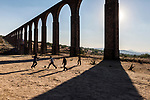 _DSC8578, Vacheron, Mexico, 02/2016, MEXICO-10081. Children play football under arches.<br /> <br /> CHECK IMAGE USAGE<br /> <br /> IG: Children play under the Aqueduct of Padre Tembleque, Mexico, 2016. 12/20/2017<br /> <br /> FINAL_Vacheron<br /> <br /> retouched_Sonny Fabbri and Ekaterina Savtsova 06/09/2016