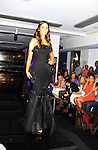 Dallas, As The World Turns' Jordana Brewster models Oscar de la Renta on the runway of Celebrity Fashion Stylist Felix Mercado's Fashion Nght Out Runway Show and After Party was held on September 6, 2012 at Loehmann's, New York City, New York with celebrities Jordana Brewster (As The World Turns, Dallas and Fast and the Furious), Lisa Vanderpump (The Real Housewives of Beverly Hills with husband Ken Todd and doggie Giggy (Gigolo) and Iris Apfel (fashion muse).  (Photo by Sue Coflin/Max Photos)
