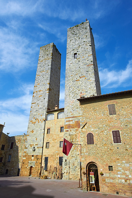 The so called twin towers of Sangimignano built in the 13th century as defensive towers and also to show prestige and wealth. The Council of San Gimignano ruled that no tower should be built higher than that of the town Hall of San Gimignano so this family built two towers to be ahead of its opposition. A UNESCO World Heritage Site. San Gimignano; Tuscany Italy