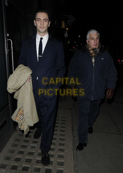 "Reg Traviss & Mitch Winehouse.attended the ""Bill Wyman : Reworked"" private view, Rook & Raven, Rathbone Place, London, England..February 26th, 2013.full length blue black shirt suit tie jacket brown gloves scarf.CAP/CAN.©Can Nguyen/Capital Pictures."