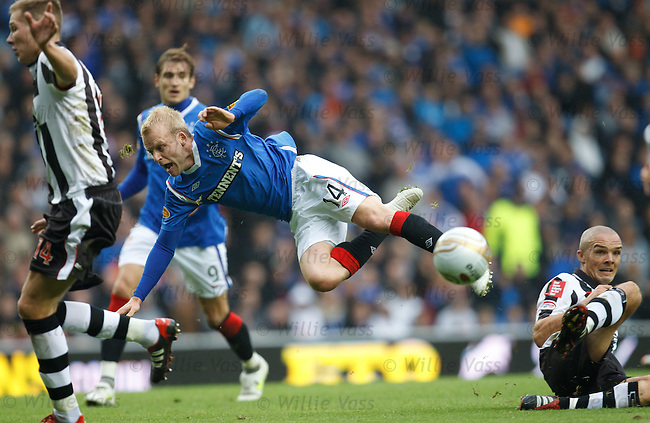 Steven Naismith is sent flying by Jim Goodwin