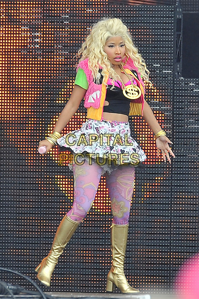 Nicki Minaj.performing at the Barclaycard Wireless Festival, Hyde Park, London, England. 7th July 2012..music live gig on stage show full length live on stage pink tights gold dollar sign necklace  gold knee high boots print patterned white mini skirt  black crop bra top  fur jacket gilet tulle microphone .CAP/MAR.© Martin Harris/Capital Pictures.