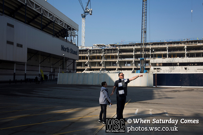 Tottenham Hotspur 4 Watford 0, 08/04/2017. White Hart Lane, Premier League. Supporters surveying the building site behind the North Stand before Tottenham Hotspur took on Watford in an English Premier League match at White Hart Lane. Spurs were due to make an announcement in April 2016 regarding when they would move out of their historic home and relocate to Wembley as their new stadium was completed. Spurs won this match 4-0 watched by a crowd of 31,706, a reduced attendance figure due to the ongoing ground redevelopment. Photo by Colin McPherson.