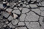 Cracked broken asphalt pavement in parking lot