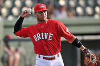 Second baseman Yoan Moncada (24) of the Greenville Drive warms up before a game against the Charleston RiverDogs on Friday, August 14, 2015, at Fluor Field at the West End in Greenville, South Carolina. Charleston won 6-2. (Tom Priddy/Four Seam Images)