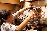 VIETNAM, Hanoi, Miss Tahi owner of Cafe Nang coffee shop prepares coffee for customers in the Old quarter