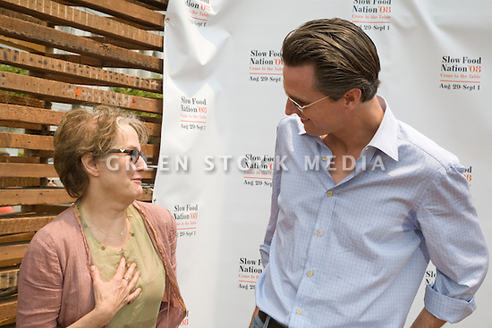 "Alice Waters, chef and founder/co-owner of Chez Panisse and San Francisco Mayor Gavin Newsom at Community Planting Day (July 12, 2008) of the Slow Food Nation Victory Garden at San Francisco's Civic Center. The garden project ""demonstrates the potential of a truly local agriculture practice that unites and promotes Bay Area urban gardening organizations, while producing high quality food for those in need.""* The garden is planted on the same site as the post-World War II garden sixty years ago. The food will be grown over a period of two months, harvested, and donated to people in need..*slowfoodnation.org"