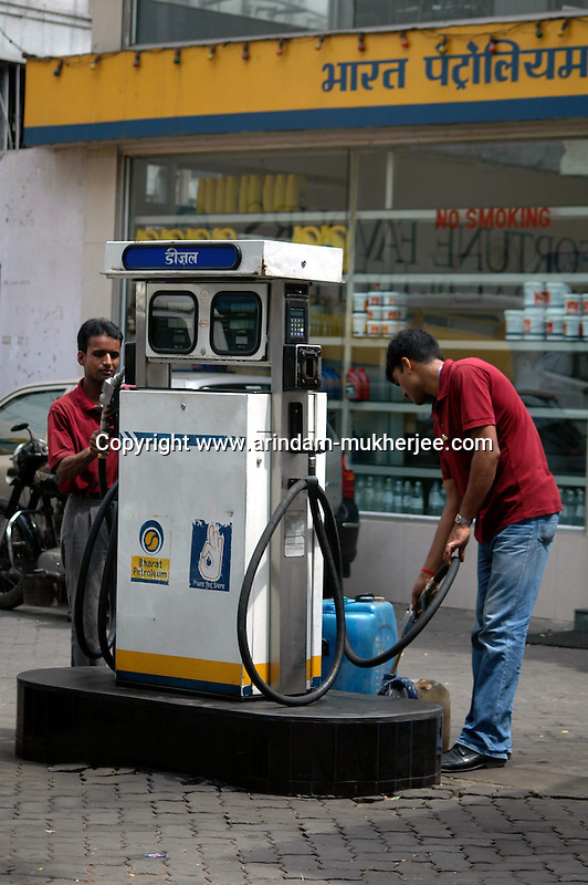 Indian ment working at a Bharat Petrolium petrol pump in Kolkata, West Bengal,  India  7/18/2007.  Arindam Mukherjee/Landov