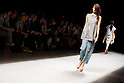 """October 16, 2012, Tokyo, Japan - A model walks down the catwalk wearing """"tiit"""" during the Mercedes-Benz Fashion Week Tokyo 2013 Spring/Summer. Fashion week in Tokyo runs from October 13-20. (Photo by Christopher Jue/Nippon News)"""