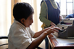 Juan Jose, 10 of Lima, learns to read and write Braille on a Brailler at the Escuela de Helen Keller in Lima, Peru.