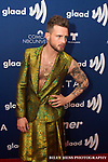 Nico Tortorella Hosted the GLAAD AWARDS Rising Stars Luncheon. Nico Tortorella is an American actor and model. He is known for his roles in the 2011 slasher film Scream 4, the Fox crime drama series The Following, the ABC Family teen series Make It or Break It, and the TV Land comedy-drama series Younger