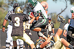 Palos Verdes, CA 10/08/10 - Josh Mcguiness (Peninsula #3) and Eric Capacchione (South #43) in action during the South Torrance Spartans vs Peninsula Panthers Varsity football game at Palos Verdes Peninsula High School.