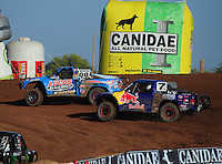 Apr 16, 2011; Surprise, AZ USA; LOORRS driver Robby Woods (99) leads Bryce Menzies (7) during round 3 at Speedworld Off Road Park. Mandatory Credit: Mark J. Rebilas-